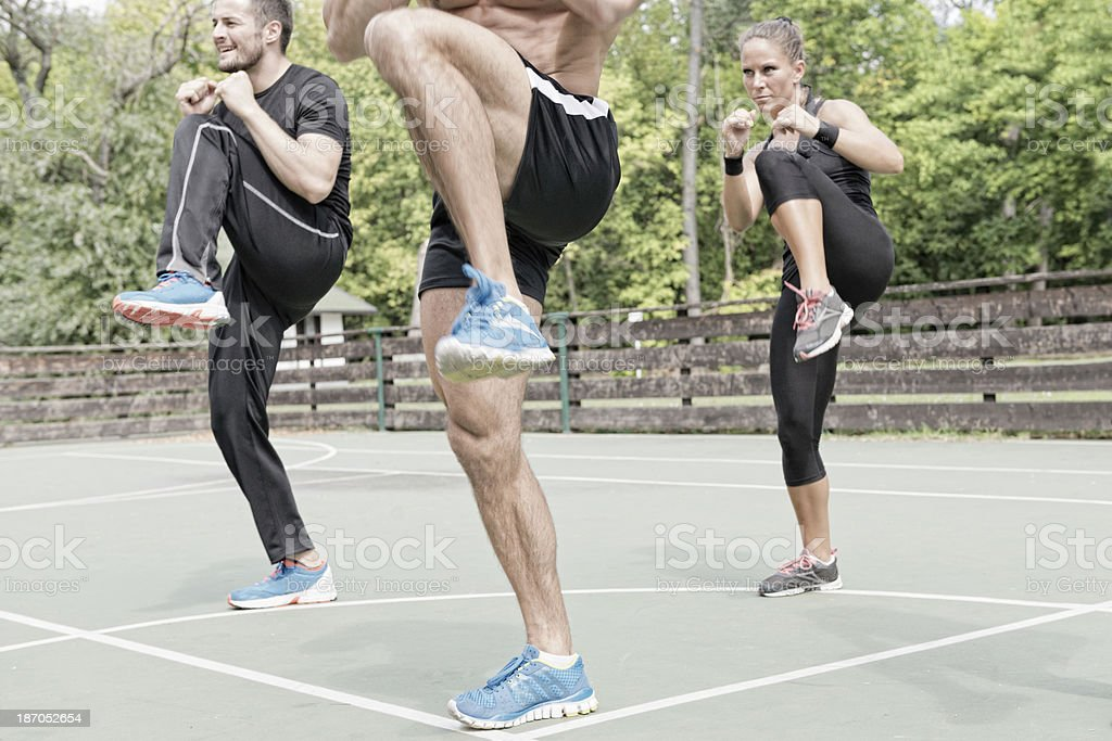 Three people on tae bo training stock photo