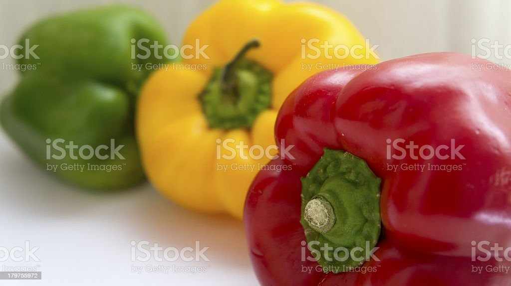 Three peppers and colors royalty-free stock photo