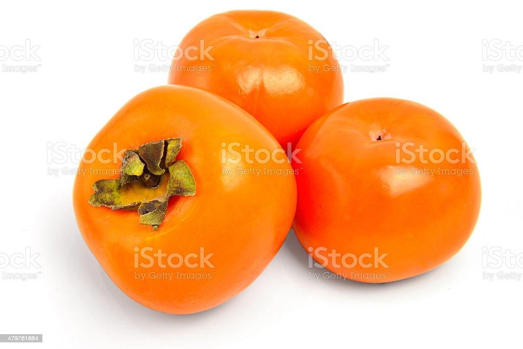 Three persimmons on white stock photo