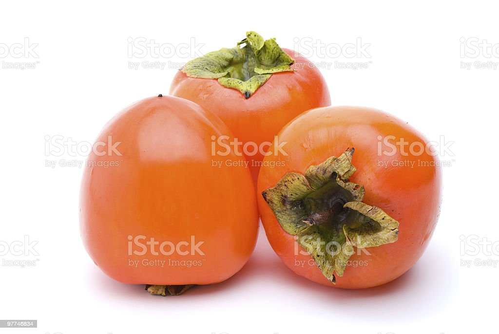 Three persimmons royalty-free stock photo