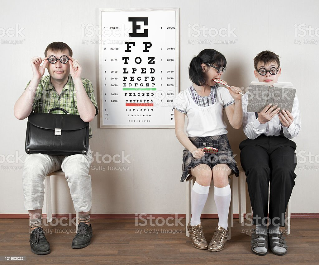 three person wearing spectacles in an office at the doctor royalty-free stock photo