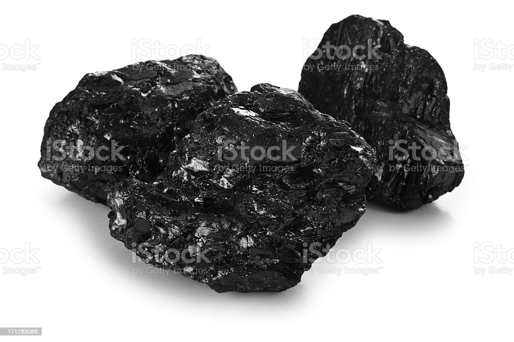 Three pieces of black coal in contrast with white background stock photo