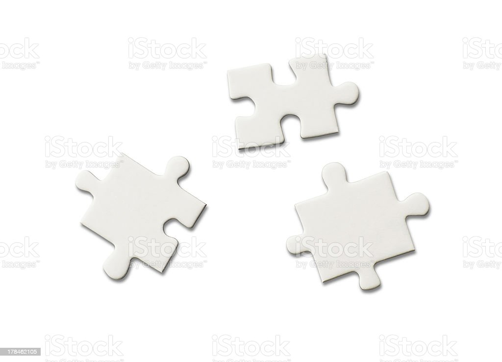 three pieces of blank jigsaw puzzle stock photo