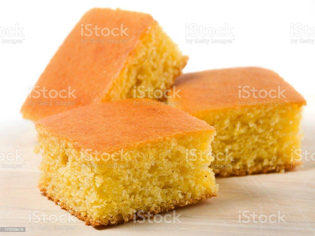 Three pieces of cornbread on white stock photo