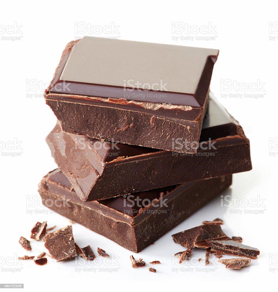 Three pieces of dark chocolate stacked stock photo