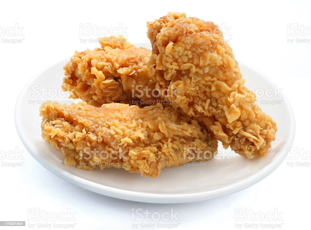 Three pieces of fries chicken stacked on small plate stock photo