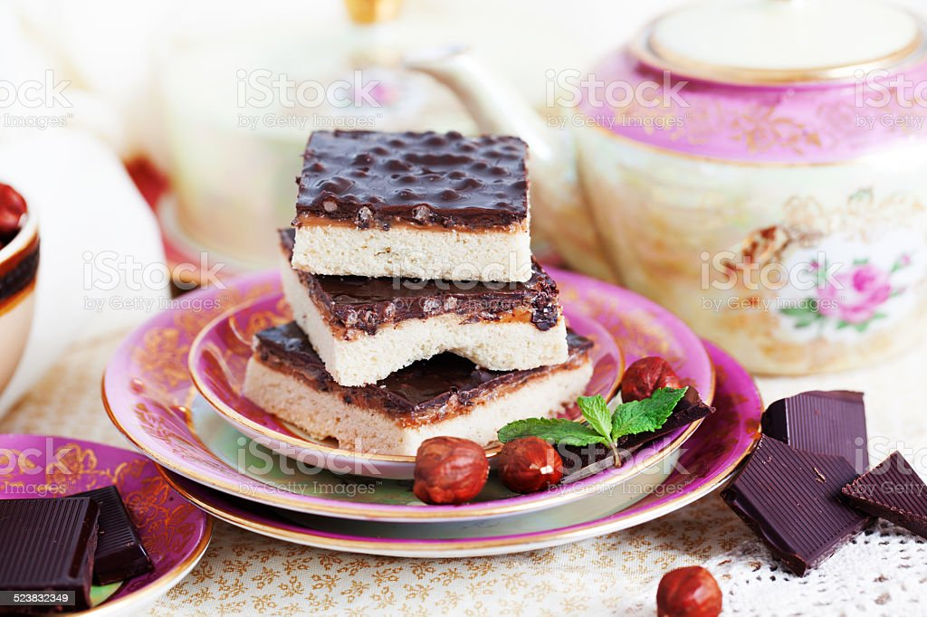 three pieces of shortcake cake with nuts and chocolate stock photo
