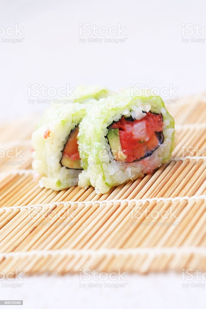 Three Pieces of Sushi on Bamboo royalty-free stock photo