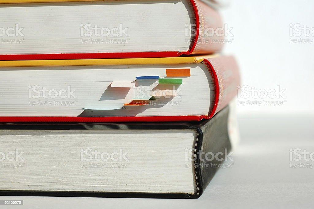 Three piled books stock photo