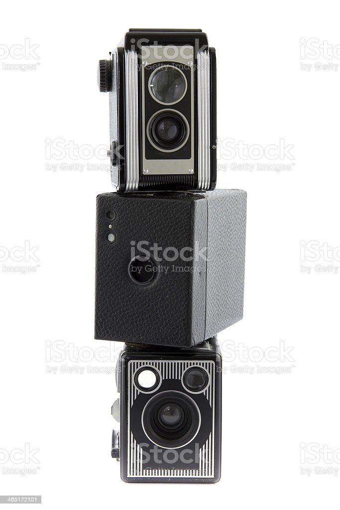 three piled photo cameras royalty-free stock photo