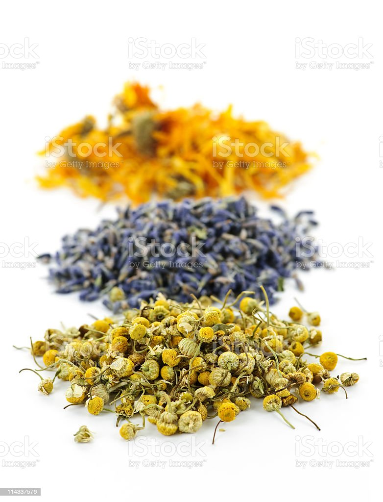 Three piles of dried medicinal herbs royalty-free stock photo