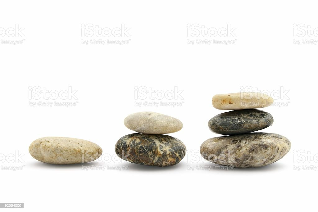 Three piles of pebbles royalty-free stock photo