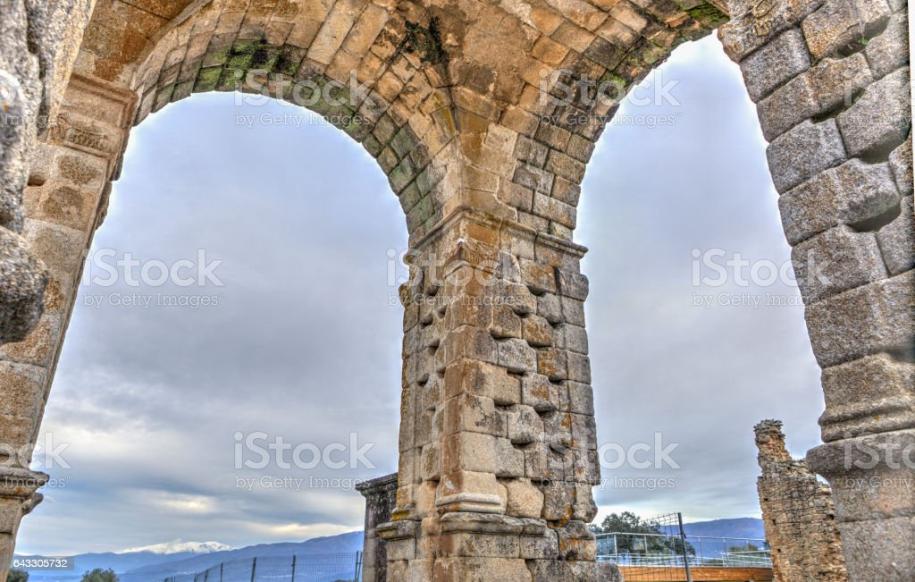 Three pillars of Roman Arch of Caparra, Caceres, Spain stock photo