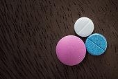 three pills on the table