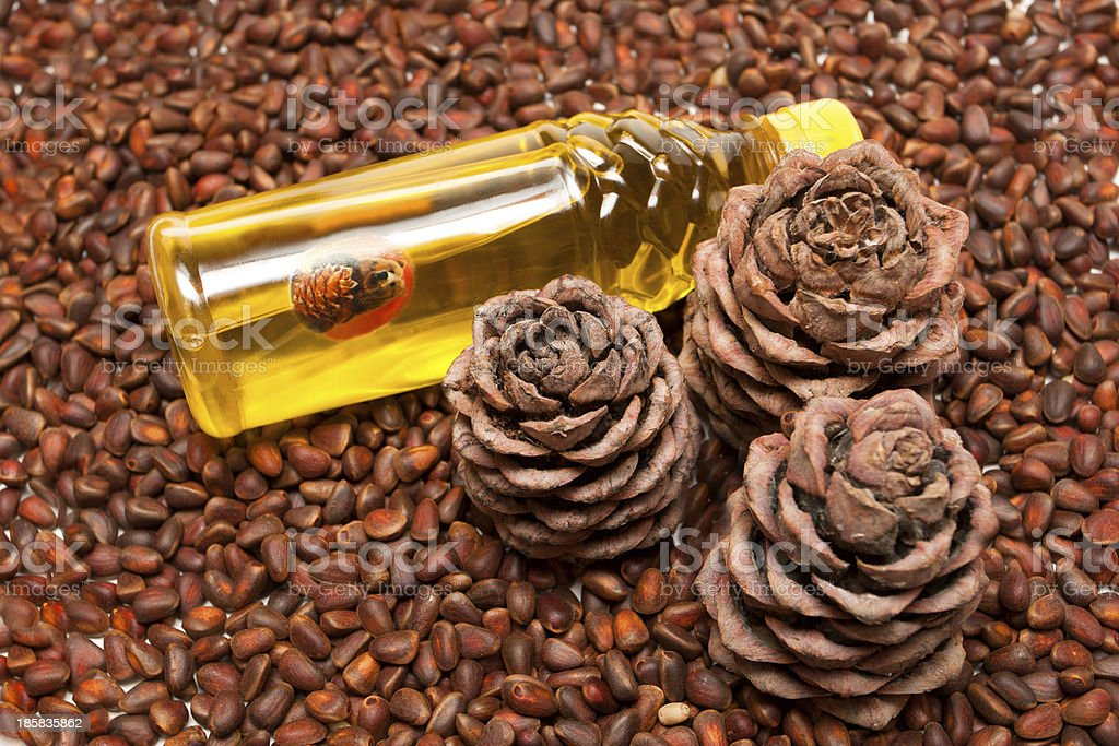 Three pine cones and oil stock photo