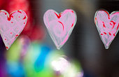Three Pink Hearts Painted on Window