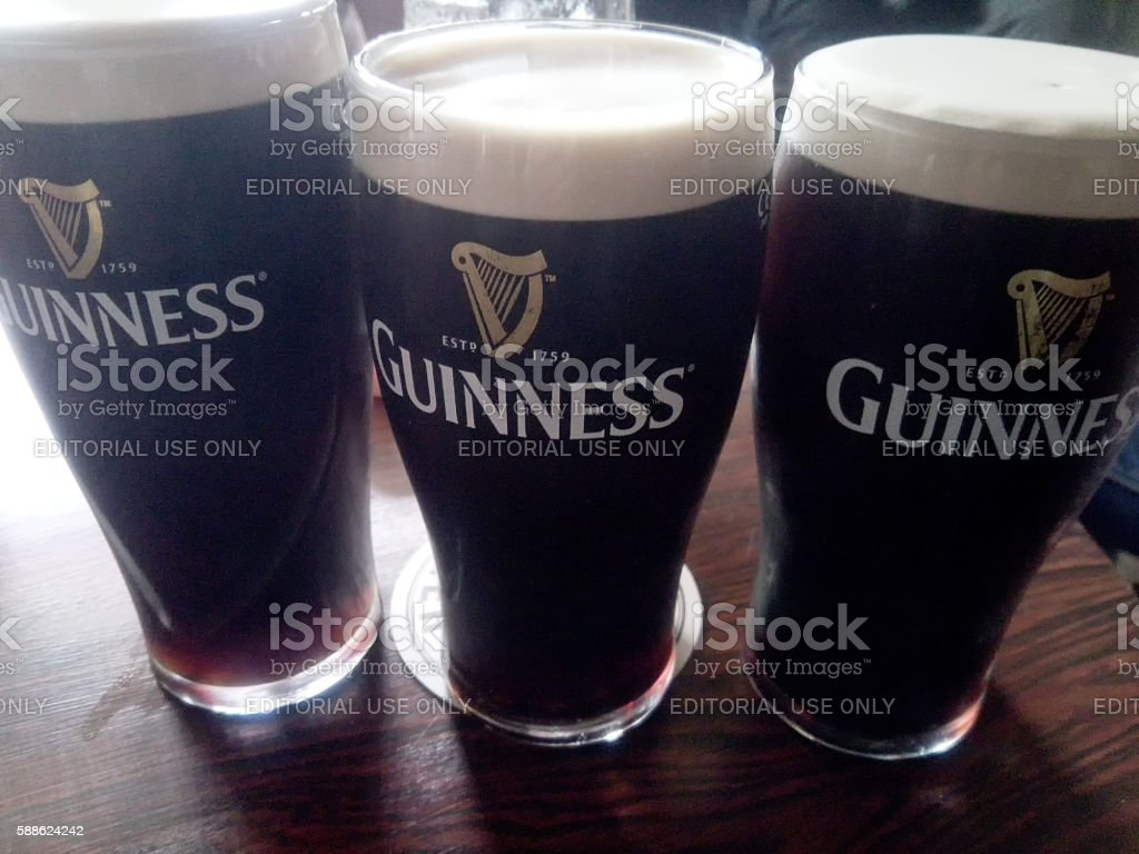 Three pints of british stout stock photo
