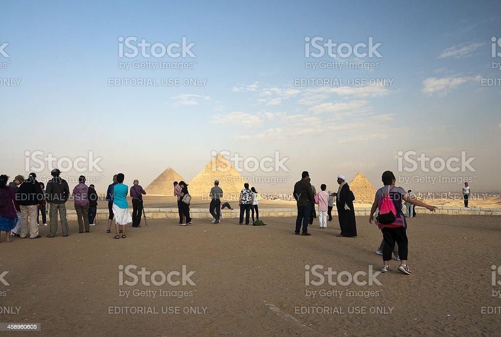Three piramids and tourists royalty-free stock photo