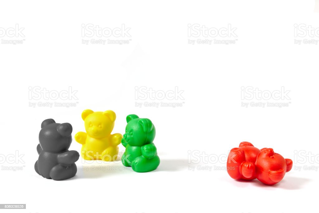 Three plastic bear figures in the colors of the coalition parties stock photo