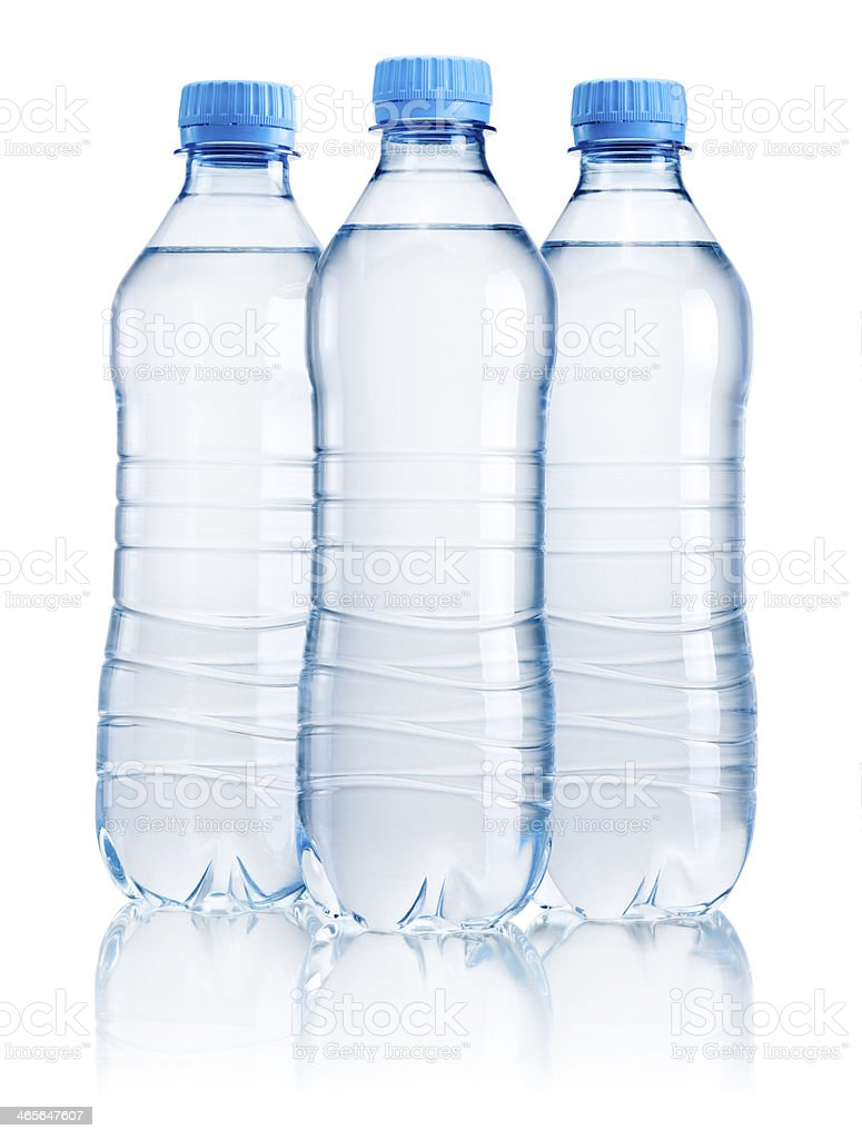 Three plastic bottle of drinking water isolated on white background stock photo