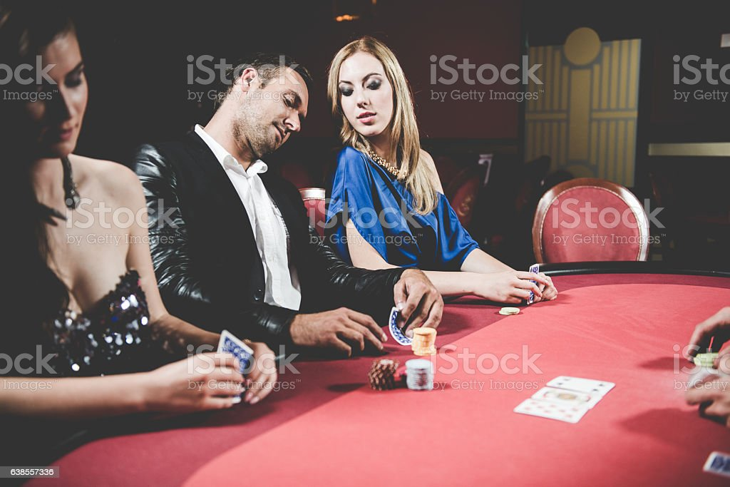Three Poker Players and Dealer at the Casino, Europe stock photo