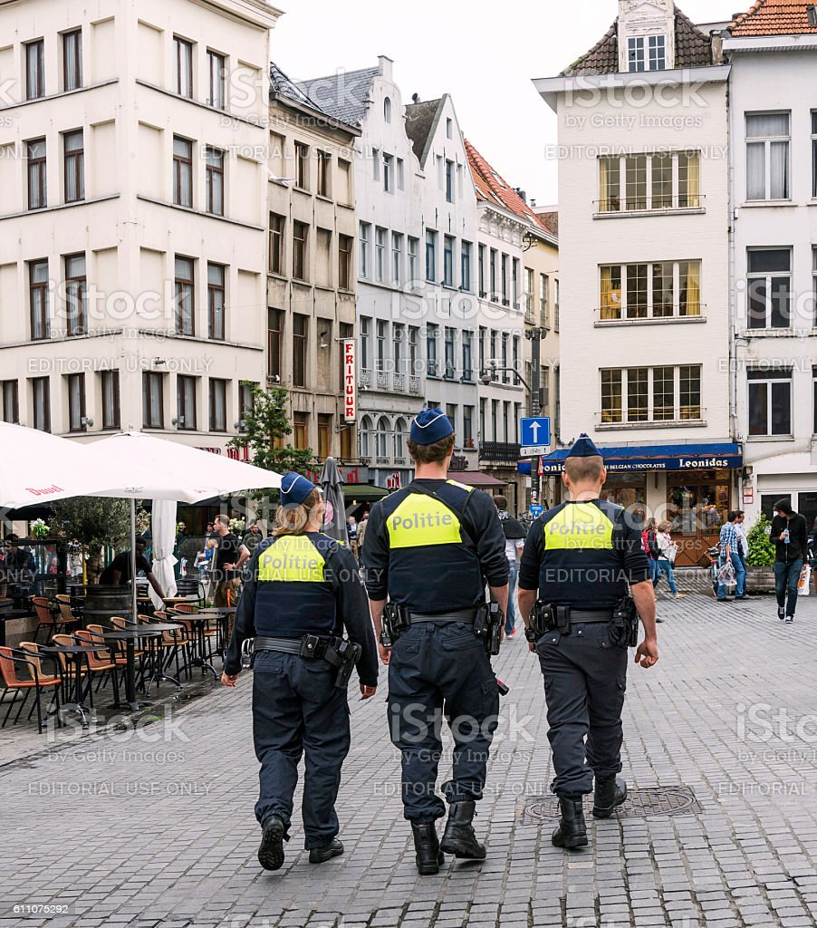 Three Police are walking in the streets of antwerp,Belgium stock photo