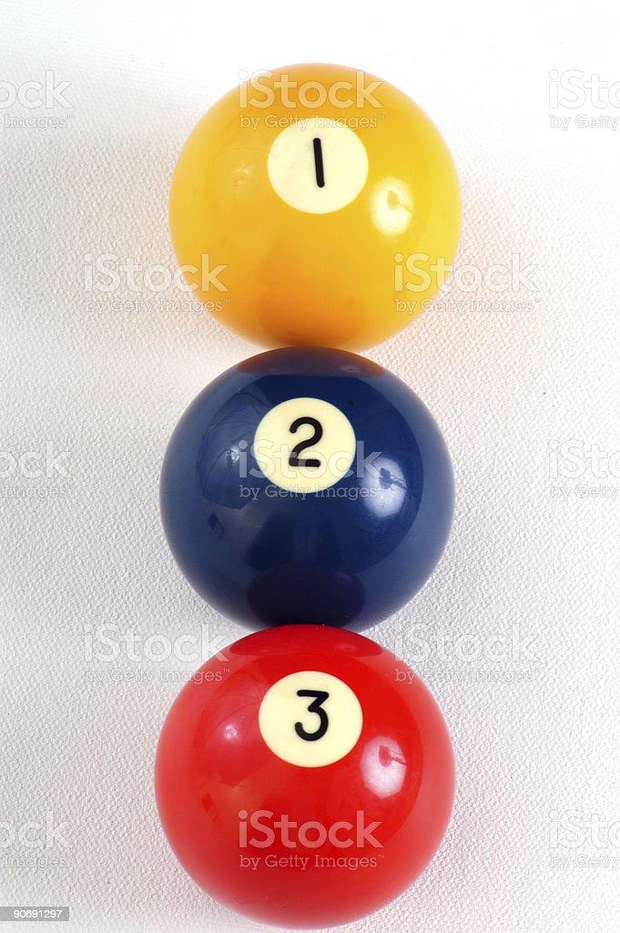 Three pool balls in a row stock photo