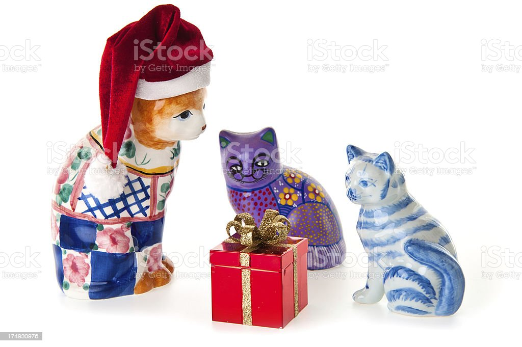 Three Porcelan Cats with Christmas Gift stock photo