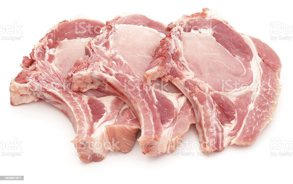 Three pork chops isolated on white royalty-free stock photo