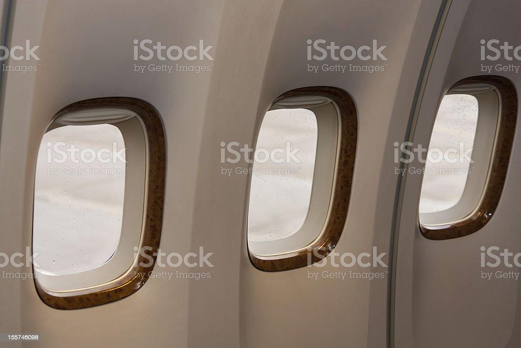 three portholes of aircraft royalty-free stock photo
