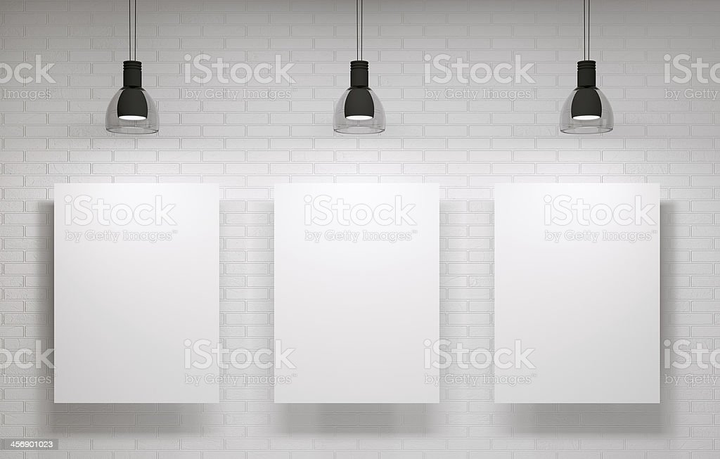 Three posters on the wall stock photo
