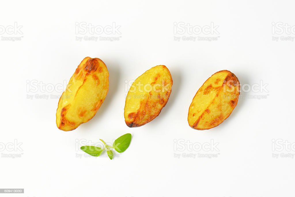 three potato wedges stock photo
