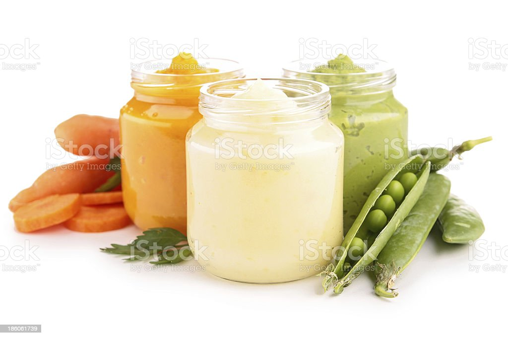 Three pots of nutritious baby food stock photo
