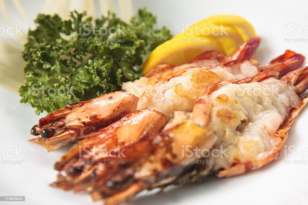 Three prawns with garnishes royalty-free stock photo