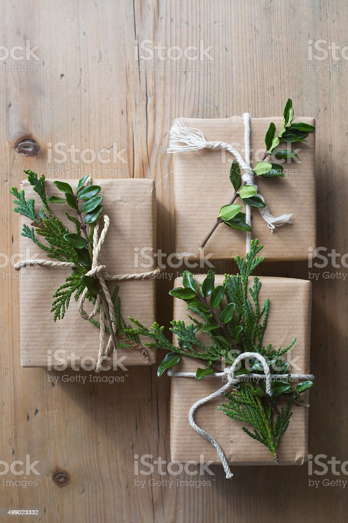 Three presents wrapped with recycled kraft paper stock photo