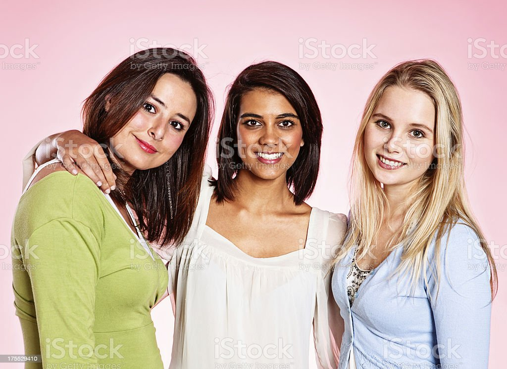 Three pretty women friends smile happily stock photo