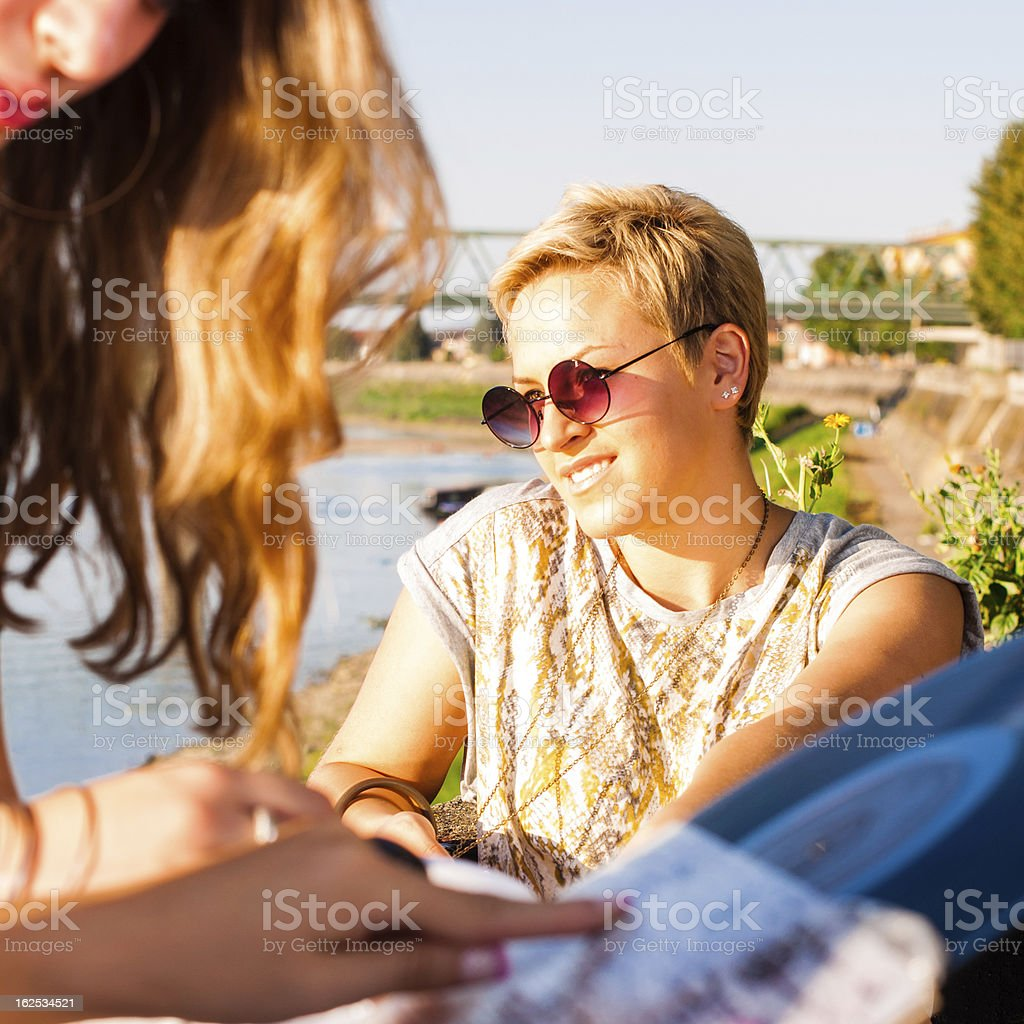Three pretty young hipster girls exchanging LPs royalty-free stock photo