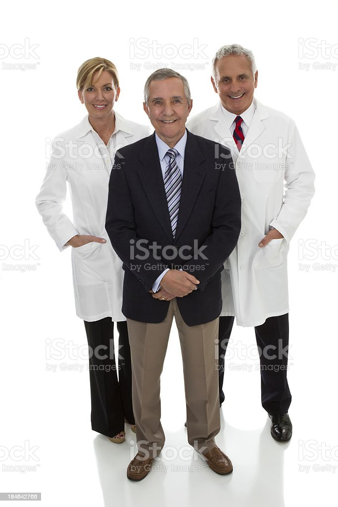 Three professional adults, two wearing lab coats one business suit stock photo
