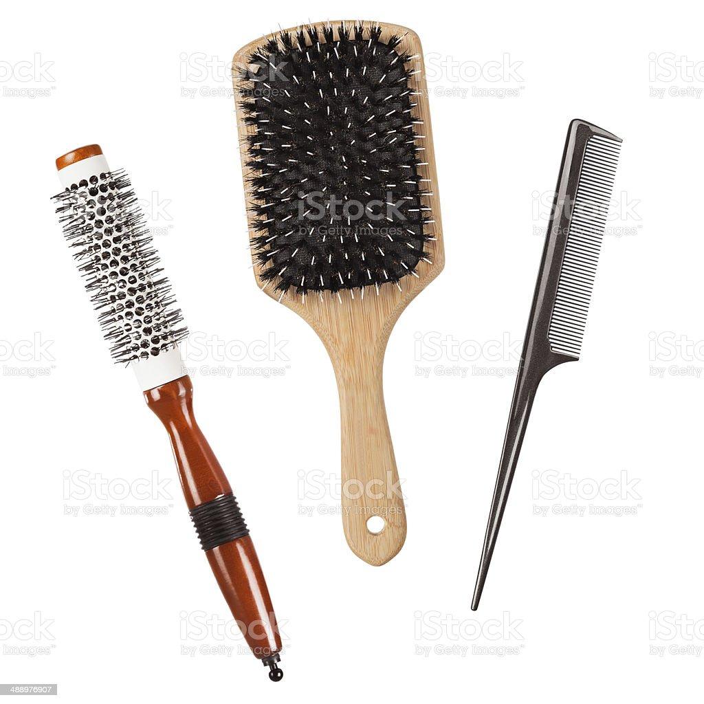 Three professional hairbrushes isolated stock photo