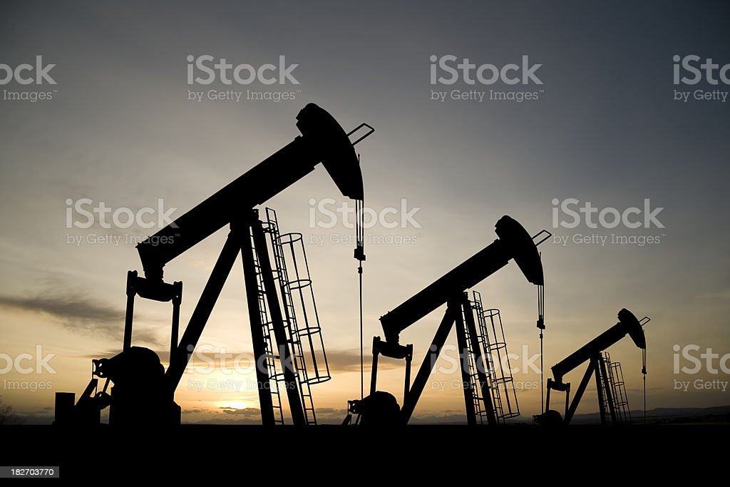 Three Pumpjacks at Dawn stock photo