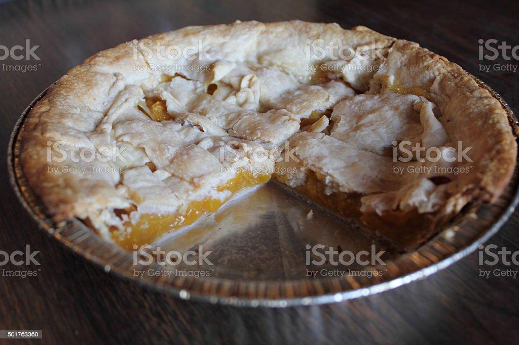 Three quarters peach pie stock photo