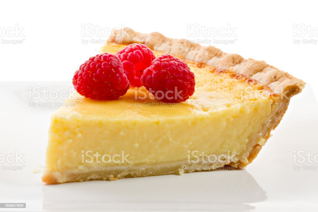 Three Raspberries On A Slice Of Custard Pie. stock photo
