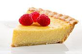 Three Raspberries On A Slice Of Custard Pie.