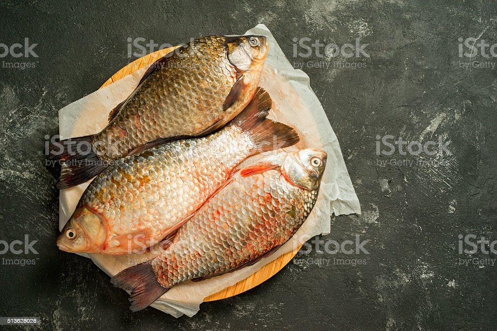 three raw carp fishes stock photo