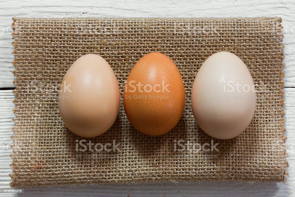 three raw chicken eggs stock photo