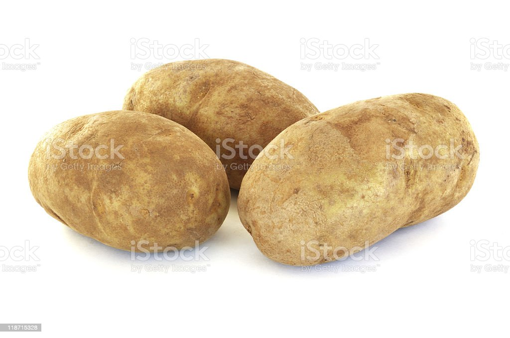 Three Raw Russet Potatoes stock photo