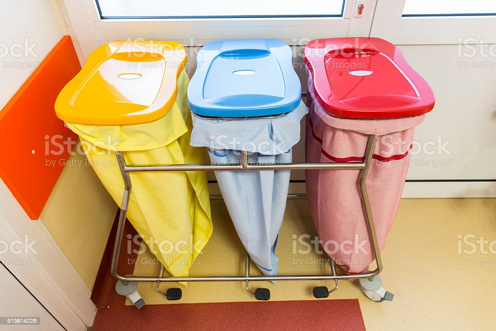 Three recycle bins in a hospital stock photo