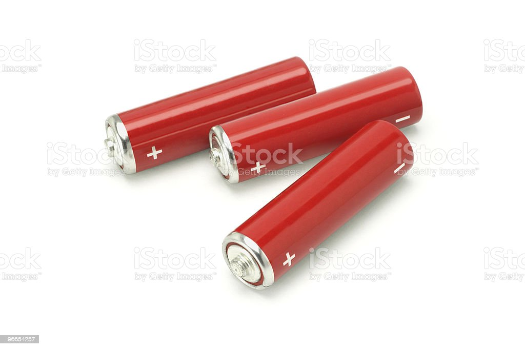 Three red AA size batteries stock photo