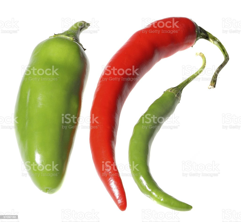 Three red and green hot peppers stock photo