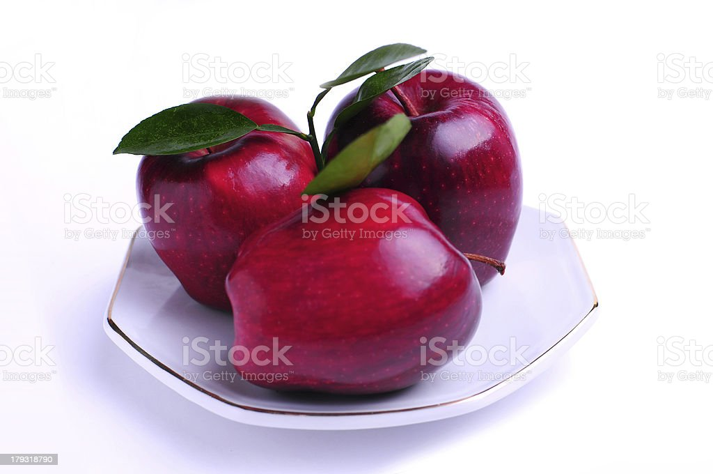 three red apples on plate royalty-free stock photo